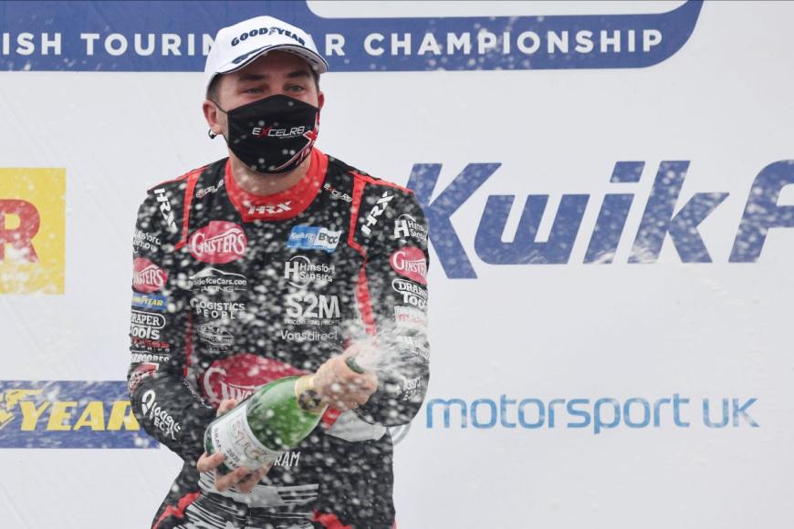 Tom Ingram spraying champagne at Brands Hatch